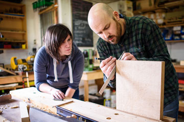Aidan with cabinet making course student