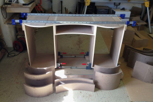 Curved panel cabinet making