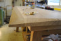 curved chamfered edges on the walnut top