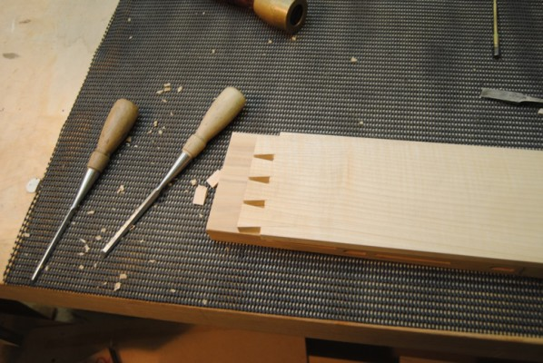 Cutting out waste from between the dovetails