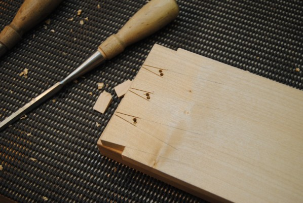 Dovetails marked out and drilled with clearance holes