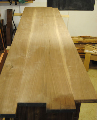 Jointed walnut top laid on the sideboard