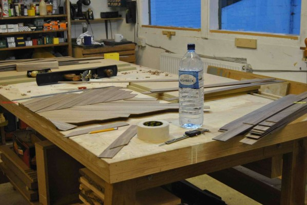 Hand jointing veneer strips on a shooting board