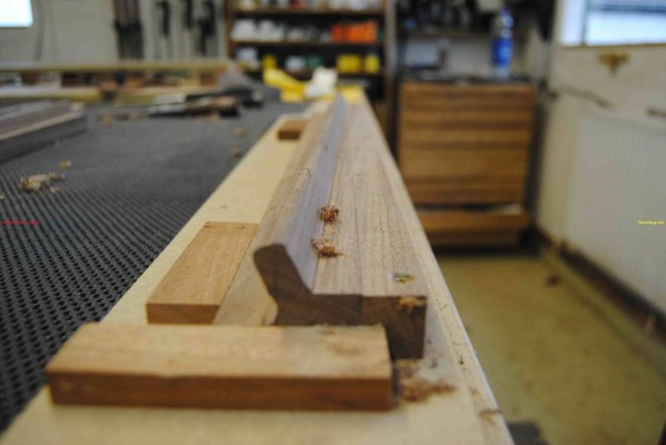 Sideboard door handle secured in custom jig