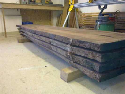 Four plank Walnut log stacked for acclimatization