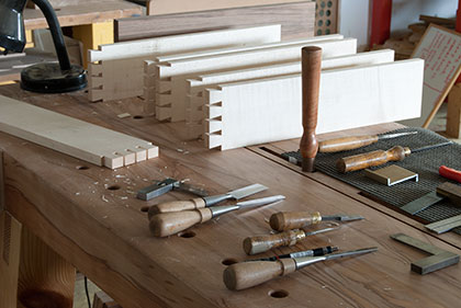 professional long-term furniture making course tools and dovetail work pieces on workbench